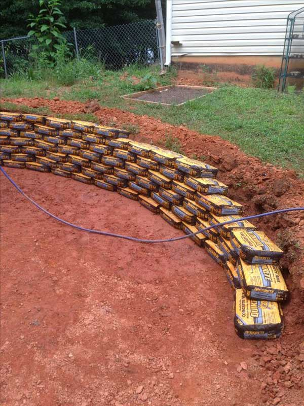 Build A Retaining Wall Using Quickcrete Bags Unopened And Stacked Like  Bricks: